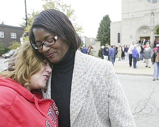 William d Lewis The Vindicator  Lisa Mansell, left, a member of St Dom's Church embraces Janet Tarpley, Y-town 6th ward councilperson at a rally aturday outside St Dom's church.