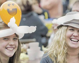 Charlotte Voytko, 11, and her mother, Kara Voytko, sport balloon hats made by a clown at the 34th annual Boardman Oktoberfest on Sunday in Boardman Township Park. They said attending the annual festival sponsored by Boardman Rotary is a family tradition.