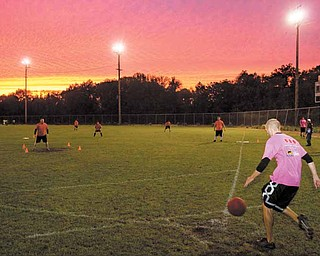 Adam Kagarise, of team, 4U2NV, winds up before a kick during a kickball game at Oakland Field on Youngstown's East Side on Wednesday evening.
