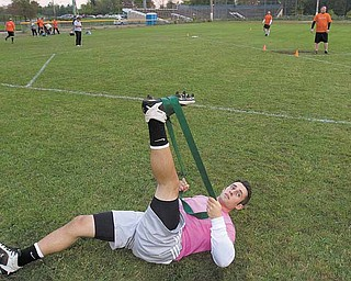 BobBovara, of Boardman, stretches out before the second game in a kickball doubleheader at Oakland Field on  Wednesday evening.