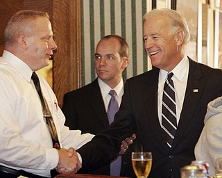 William d Lewis The Vindicator   VP Joe Biden shakes hands with John Naples, one of the owners of the Golden Dawn during a visit Monday by the VP to Youngstown.