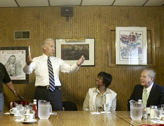 William D. Lewis | The Vindicator ||  Vice President Joe Biden, standing, talks during lunch at the Golden Dawn with, from left, Alice Lev, John Kopp, Cynthia McWilson, Ohio Gov. Ted Strickland, and two unidentified area residents.