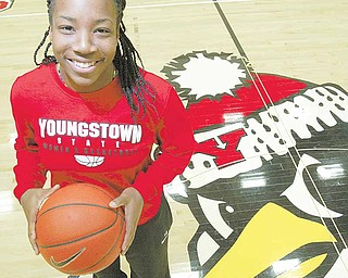 Youngstown State basketball player Macey Nortey stands at center court of the Beeghly center during media day. Nortey, a junior guard, is one of four returning starters for the Penguins, who began practice for the first time under new head coach Bob Boldon on Monday — about two weeks earlier than the NCAA has allowed in previous years.