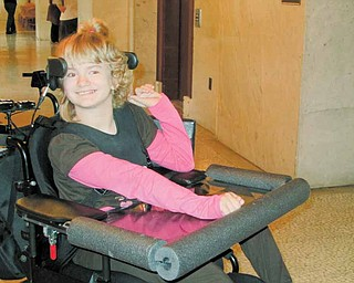 Haley Cobb, 10, of Leavittsburg, takes a break outside of the  courtroom of Judge W. Wyatt McKay in Trumbull County Common Pleas Court. Her parents sued the doctor who delivered her in January 2000 for medical malpractice, saying the doctor's failure to suggest Haley be delivered by Caesarean section caused the child's cerebral palsy.