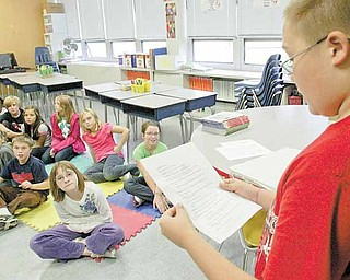 """Evan Shobel, a fifth-grader and member of the Frank Ohl Intermediate School Drama Club, reads a part during auditions for """"A Christmas Carol,"""" the school's first play, based on Charles Dickens' famous story."""