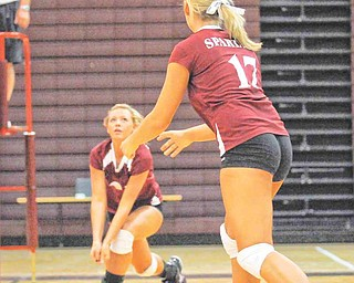 Boardman's Casie Saunders, left,  Keyleigh Lipke (17) Amanda Volsin (14) cover the ball against Hoover during their game at Boardman on Tuesday night.