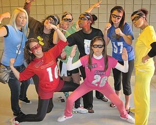 Ursuline irish girls cheer on the senior boys dressed as superheroes