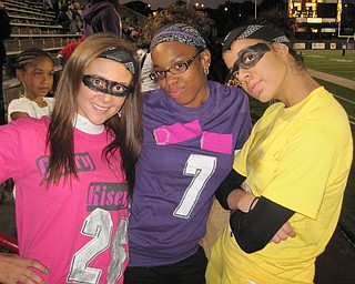 Ursuline irish fans dressed as superheroes for the game