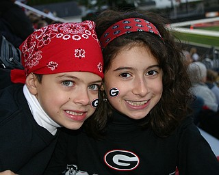 Young Girard fans, Francesca and Dante Byrne show their Indian spirit at the game against Hubbard.
