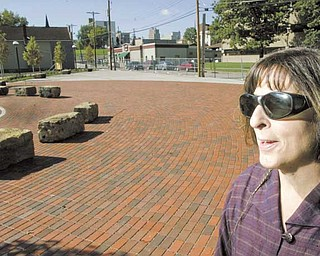 Martha Morgan, project manager at Wick Neighbors Inc., looks over Harrison Common, the first project in an overall plan to revitalize Youngstown's Smoky Hollow neighborhood.