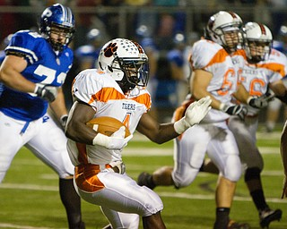 Geoffrey Hauschild|The Vindicator.Howland's Deveon Smith (4) makes a run downfield during the first quarter of a game at Poland High School on Friday evening.