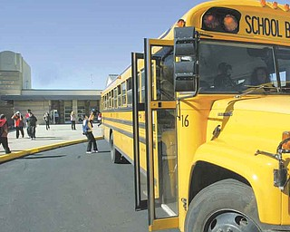 Students board buses at Campbell Middle School