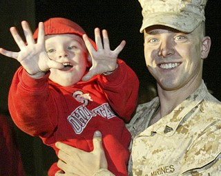 William D. Lewis|The Vindicator Marine Reservist Seth Tipton of Cambridge, OH is greeted by his nephew Conner Tipton upon arriving at the Youngstown Airbase  from Afghanistan Thursday night.