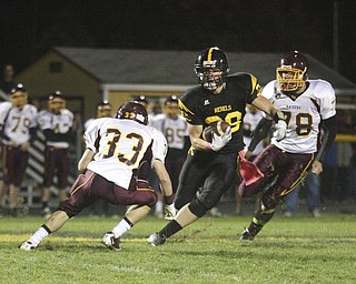FOOTBALL - (28) Andrew Mayer tries to get past (33) Alex Dickey as (78)Christian Bowden tries to get in on the play Friday night at Crestview. - Special to The Vindicator/Nick Mays