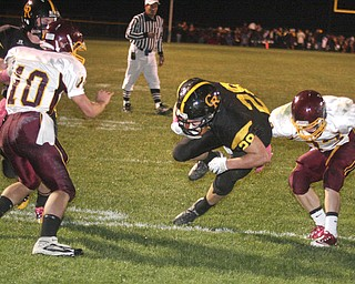 FOOTBALL - (28) Andrew Mayer gets past (33) Alex Dickey for a touchdown Friday night at Crestview. - Special to The Vindicator/Nick Mays