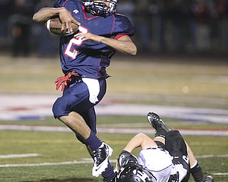 ROBERT K. YOSAY | THE VINDICATOR..Going for  1st and then and then  some as #2 Demitious Davis dances by Perrys #24  Tony Magnacca  .....Austintown Fitch hosted Massilon Perry Panthers  at Fitch Stadium...  --30-..