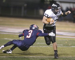 ROBERT K. YOSAY | THE VINDICATOR..Fitchs #3  Cameron Patterson  reaches back to grab Perry's #33  ----------Austintown Fitch hosted Massilon Perry Panthers  at Fitch Stadium...  --30-..