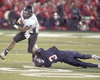 ROBERT K. YOSAY | THE VINDICATOR..#3 Demitrious Davis -  takes down   #7  by a shoe string -  Austintown Fitch hosted Massilon Perry Panthers  at Fitch Stadium...  --30-..