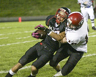 William D. Lewis|The Vindicator Girard's Bryan Daugherty tackles  Red Devil's Richard Bledsoe during 1 rst half action Friday at Campbell.