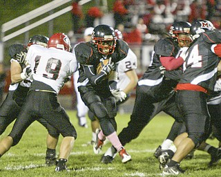 William D. Lewis|The Vindicator Campbell's Ja Les Hughes finds a hole during 1 rst half action Friday at Campbell.