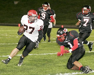 William D. Lewis|The Vindicator Girard's Zach Cochran eludes Red Devil's Claxton LeBron during 1 rst half action Friday at Campbell.