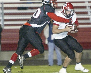 William D. Lewis|The Vindicator Campbell's#40- not on roster sacks Girard QB #2 not on roster during1 rst half action Friday at Campbell.