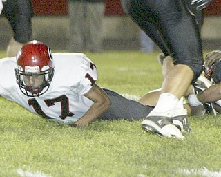 William D. Lewis|The Vindicator Girard's #17 extends for a first down during 1 rst half action Friday at Campbell.