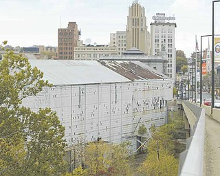 A look at the Wean United Building looking north from the Market Street bridge in downtown Youngstown. The city plans to seek $1.5 million from the state to clean up and partially tear down the building.