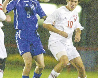 Poland High's Dan Montgomery, left, and Niles' C.J. Cicero go for the ball during Tuesday's Division II boys soccer tournament game at Bo Rein Stadium in Niles. The Red Dragons advanced with a 3-2 victory.