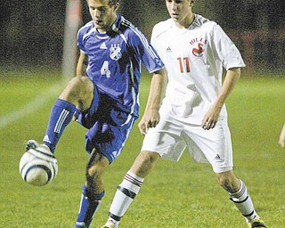 Kevin Krumpak (4) of Poland controls the ball as Niles' Bruce Hilemann defends during the boys Division II soccer tournament game in Niles on Tuesday night.