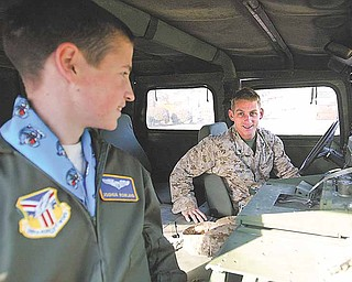 Cpl. Randy Kibler, of the United States Marine Corps, gets ready to take Joshua Rowland, of Canfield, for a ride in a military HUMVEE just after Rowland was sworn-in as an honorary Air Force Reserve 2nd lieutenant Wednesday.