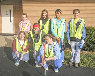 Members of the Rotary Club of Austintown and of the Fitch Interact Club spent a recent Saturday morning cleaning up the Kirk Road area, from state Route 46 to Whispering Pines Drive. Among those participating in the 10-year-long project were, from left, front row, Rebecca Leonard, Sammi Devenport and Christine Holmes, and in back, Courtney Francis, Summer Tarr,  Brianna Traylor and David Dalvin. In cooperation with the Green Team the cleanup crew not only picked up the debris, but also separated the recyclable items from the trash. As a result they accumulated three bags of recyclables and ten bags of trash.