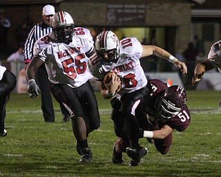 FOOTBALL - (10) Kyle Ohradzansky can't shake (51) Zach Machuga during their game Thursday night. (55) Philleano Kennard tries to get a block. - Special to The Vindicator/Nick Mays