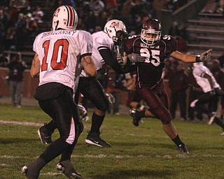 FOOTBALL - (95) Eric Yovanovich tries to get to (10 Kyle Ohradzansky during their game Thursday night. - Special to The Vindicator/Nick Mays
