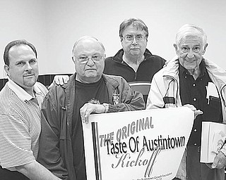 "Sign language: Austintown Growth Foundation is sponsoring a ""Taste of Austintown"" fundraiser as a benefit for various projects in the community. Displaying a sign announcing the kickoff of the event are, from left, David Ditzler, foundation president; Bill Sywy; Jack Sovik; and Art DePaolo. Austintown restaurants have donated gift certificates to be raffled off on Feb. 7. First prize will be $750 worth of gift certificates; second prize will be $500 worth of gift certificates; and third prize will be $250 worth of gift certificates. Tickets for the raffle are being sold for $5 each. For ticket information call Carol Fye at 330-792-8239."