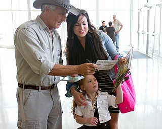 Geoffrey Hauschild|The Vindicator.Boardman residents, JoAnne Forgach and her daughter, Jewel, 3,receive an autograph from Jack Hanna during a performance by the Youngstown Symphony in conjunction with Jack Hanna at the DeYor performing Arts Center on Sunday afternoon.