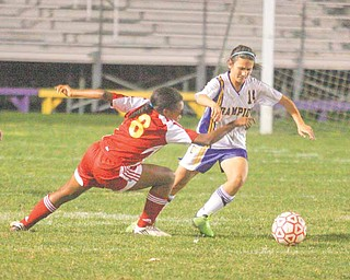 (14) Jenn Termine of Champion gets past (8) Lindsey Parkins during their game Monday night.