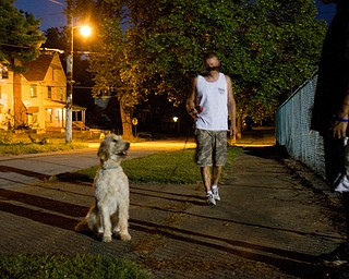 Geoffrey Hauschild|The Vindicator.8.6.2010.Students walk the center's dog, Hannah, along Florencedale Ave outside the center on Youngstown's north side.
