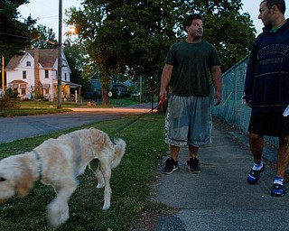 9.21.2010.John Walsh and Scott Fabry walk the center's dog, Hannah, in front of the OVTC facility on Youngstown's North Side.