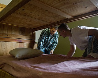 Geoffrey Hauschild|The Vindicator.10.14.2010.Bob Pavlich and Dennis McKenney make space for another bed at Ohio Valley Teen Challenge in hopes of being able to accept more people into the program.