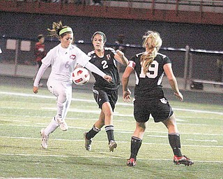 (6) Tori Koch of Fitch tries to get past (2) Selena Dasari and (19) Katie Carlisle during their game Wednesday night in Austintown.