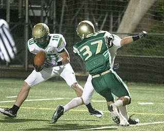 FOOTBALL - (10) Jordan Markota pulls in a pass and scores as (33) Jeff Podolsky blocks (37) Mark Murphy during their game Thursday night in Akron. - Special to The Vindicator/Nick Mays