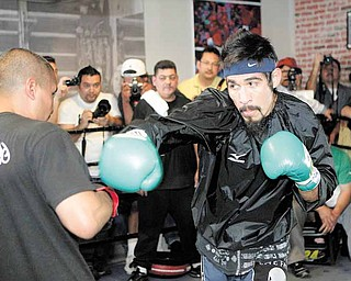 Antonio Margarito, right, of Mexico, trains with Robert Garcia during a workout for his upcoming fight with Manny Pacquiao, Thursday, Oct. 28, 2010, in Los Angeles. Nearly two years after a hand-wrapping scandal nearly ended his boxing career, Margarito still insists he didn't know his former trainer had placed illegal pads atop his fists. He's still banned from fighting in California and Nevada. (AP Photo/Jae C. Hong)