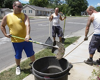 Geoffrey Hauschild The Vindicator 7.01.2010 OVTC residents John Kelly, Eric Gorniak and intern Greg Todd work as part of a regular crew doing landscaping work Arlington Heights.