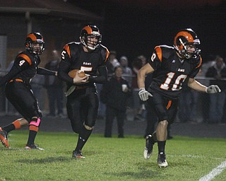 FOOTBALL - Dan Skiba follows the blocking of Mike Kellerman as (4) Jesse Garland keeps his eyes on the play Friday night in Mineral Ridge. - Special to The Vindicator/Nick Mays
