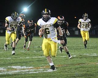 FOOTBALL - Carter Hill is all smiles as he breaks off a long gain Friday night in Mineral Ridge. - Special to The Vindicator/Nick Mays