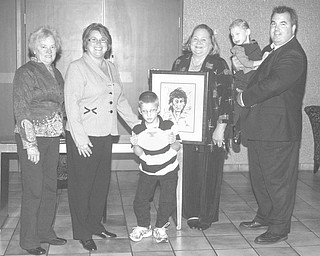"""Nick Mays  Special to The Vindicator: From left to right are Sally Reedy; Shelly LaBerto; Hunter Crites, a former Easter Seals child; Susan Berny; and Todd Franko, holding Cody Denmeade. The stories of Hunter and Cody will be featured at the """"Magic of the Angels Christmas,"""" an Easter Seals fundraiser to take place Nov. 20 at Mr. Anthony's Banquet Center in Boardman."""