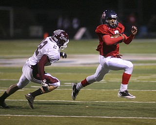 ROBERT  K.  YOSAY    THE VINDICATOR --..Fitchs #2  Demetriuous Davis Sprints away from Bdm Defender #22  Allen Starkey - Demetrious would get hurt onthis play and not return to action - .Boardman battled  Fitch at Fitch Stadium Friday Night as the Regular season drew to a close -.... -30-(AP Photo/The Vindicator, Robert K. Yosay)