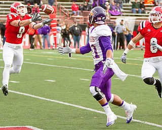 Geoffrey Hauschild The Vindicator.YSU's Will Shaw (9) intercepts a ball intended for Iowa's Josh Collins (21) and runs it back downfield nearly scoring a touchdown in the second quarter of a game at Stambaugh Stadium on Saturday afternoon.