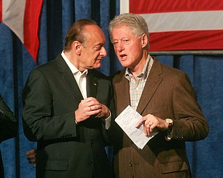 ROBERT  K.  YOSAY    THE VINDICATOR --...Former President Bill Clinton shares a moment with Lee Fisher who is running for senate as Mr Clinton visited the Mahoning County Democrats annual breakfast Saturday morning in Youngstown..The former president was stumping for democratic hopefuls in state and congressional races here in Ohio .... -30-(AP Photo/The Vindicator, Robert K. Yosay)